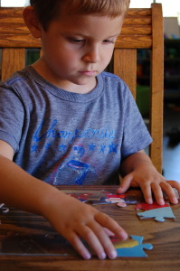 Child Playing with Puzzle